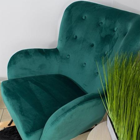 Bujany fotel uszak na drewnianych płozach nowoczesny solidny zielony